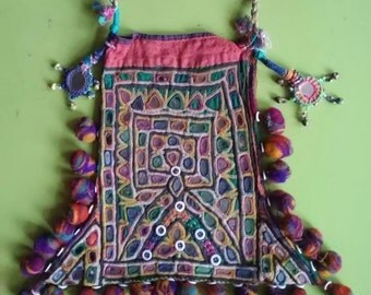 Antique embroidered Banjara Kutch bag with mirrorwork and woolen multicolored pompons