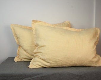 Pair of 100% linen pillow shams. MIDSUMMER bedding collection. Cream-peach color. Standard, queen, king, other custom sizes. Stone washed.