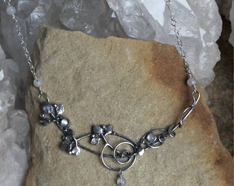 Sterling Silver elfin necklace of intertwined branches hung with a crescent moon and set with moonstones