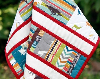 Organic baby or toddler quilt featuring elephants, giraffes, jungle, made with Serengeti from Birch Fabric and tummy time ready, Made in USA