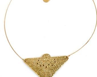 serious necklace bronze gold arabesques.