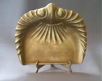 A brass Art Deco crumb tray by Joseph Sankey & Sons of Bilston, Wolverhampton, England showing their 'Neptune' trade mark, circa 1922