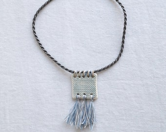 Blue square knit TASSEL necklace with blue tassels, short twisted grey satin cord, artisan ceramic porcelain pendant, grey glaze