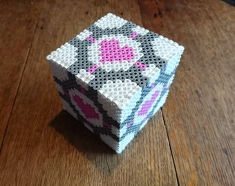 Portal Inspired Weighted Companion Cube