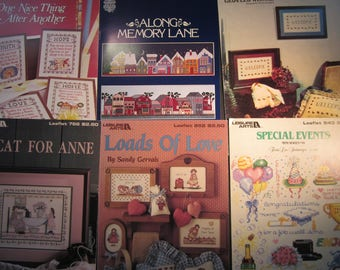 6 cross stitch pattern booklets, Welcome, special events, Loads of Love, A Cat For Anne,Along Memory lane,Faith,Love,Hope,sayings,baby birth