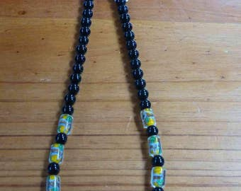 C66  Yellow Cylinder Art Glass and black onyx bead necklace.  20 inch