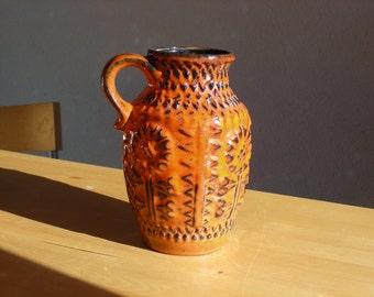 Bay Ceramic 258 20 vase in bright orange color with sunflower design