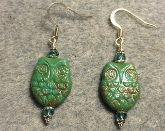 Green with light Picasso wash Czech glass owl bead earrings adorned with aqua green Chinese crystal beads.