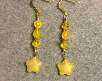 Opaque yellow Czech glass star bead dangle earrings adorned with yellow Czech glass beads.