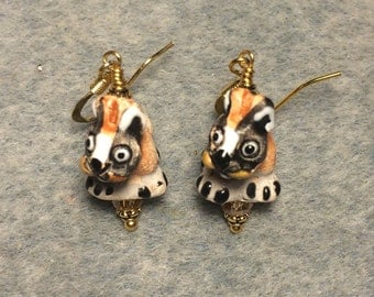 Small black, grey and tan ceramic dog bead earrings adorned with grey Chinese crystal beads.