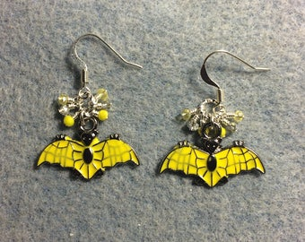 Yellow enamel bat charm earrings adorned with tiny dangling yellow and silver Chinese crystal beads.