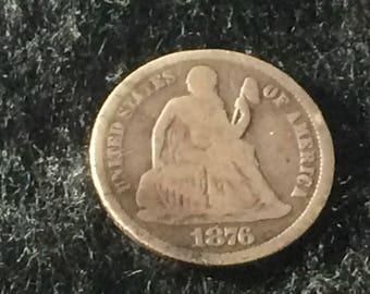 1876 Silver Seated Liberty Dime from the Philadelphia Mint in Good-Very Good Condition
