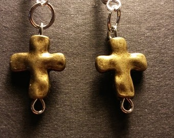 Cross earrings made out of metal