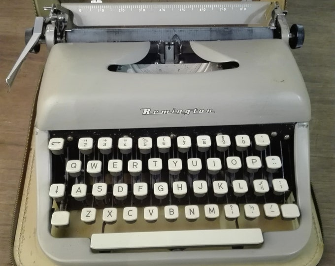 Remington Grey steel typewriter, leather casing