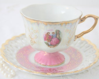 Elegant Footed Versailles Teacup and Saucer, Fragonard Decor, Pink and White Lustreware, Reticulated Rim, France