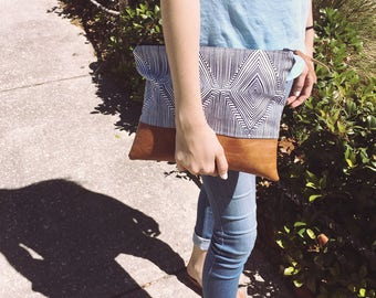 Geometric leather clutch bag