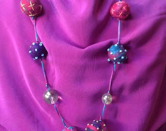 Necklace  Glass/Felted Beads with a Golden Heart Pendal