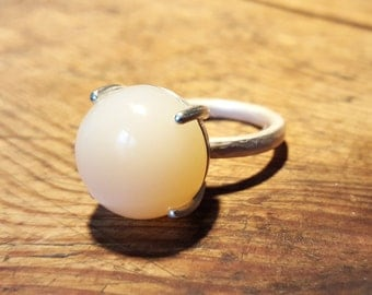 white moonstone silver ring with claw setting