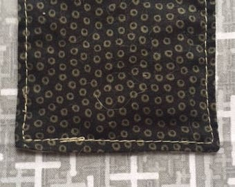 The Pocket Cross: Circles on Black Over Gray Crosses Fabric