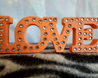 Freestanding word 'love' in shimmering mint, blue or peach and clear rhinestones