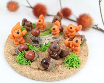 Squirrels in cold porcelain plate