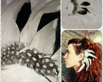 Left ear. Handmade black and white feather ear cuff