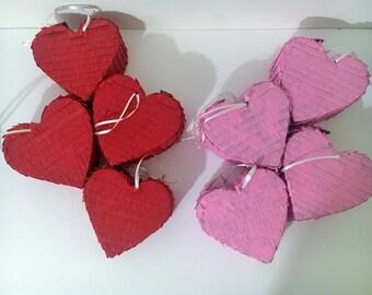 8 small pink and red hearts pinatas