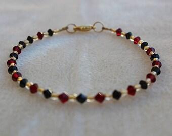 Red, Black, and Gold Swarovski Bracelet
