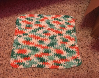 Green, orange, and white crocheted dish cloth