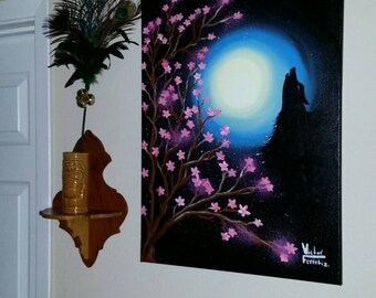 Wolf and moon with cherry blossom tree.