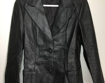 Black leather jacket woman size small - medium .