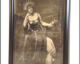 Aged reproduction Victorian framed print of an exotically attired lady.