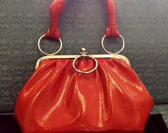 Cherry red vintage handbag with silver accents