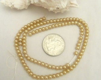 Strand of 4 mm Glass Pearls - Old Gold (1956)