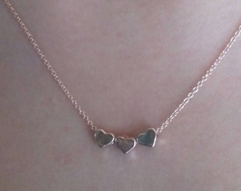 Rose gold colored 3 heart charm necklace