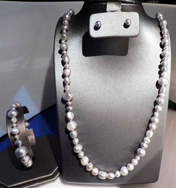 3 feet of Silver Freshwater Pearls with stud earrings and bracelet