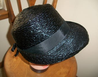 Vintage 1970's Black Straw Hat. Up Or Down Brim With Wide Grosgrain Band & Small Bow In Back. Has Union Tag.