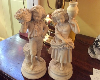 Classic boy and girl statue