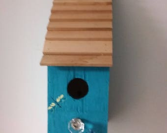 Handcrafted wood birdhouse
