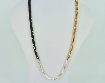 Long kumihimo necklace in gold, black en pearl white