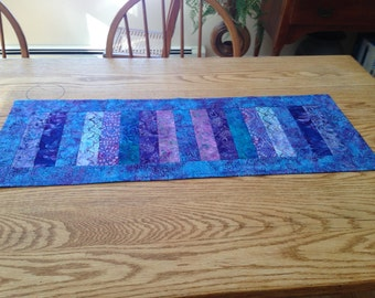 Purple and turquoise batik table runner