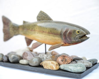 Carved Wooden Cutthroat Trout over River Rock