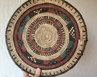 "African woven basket // Nigerian // natural colors, accented with teal, black, rust colors // 13"" round"