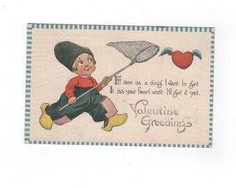 Antique Valentine's Day postcard. Dutch boy with net. Vintage 1913 collectible ephemera.