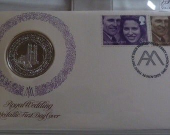 a solid silver royal wedding coin and stamps