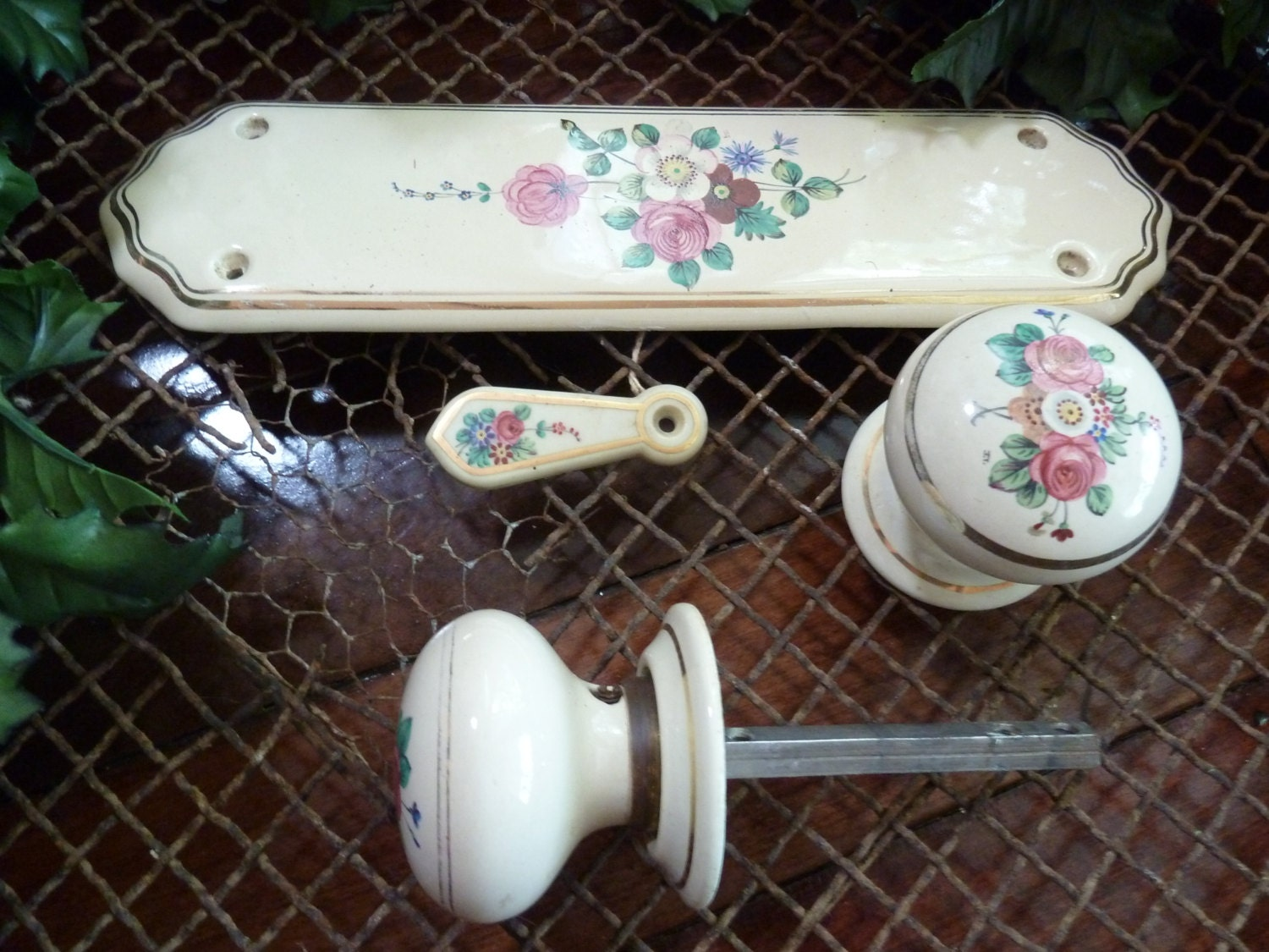 two porcelain door knobs and one door plate and escutchion ...