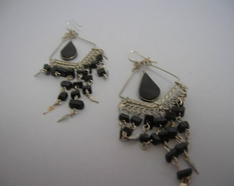 A pair of black and silver earrings