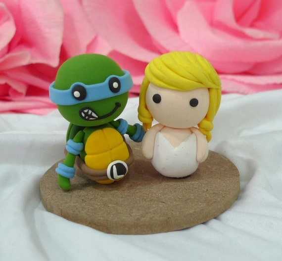 Wedding cake topper Ninja Turtle and Mary Jane clay doll