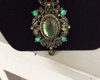 Beautiful green brooch type necklace.