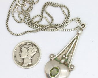 Vintage silver and peridot pendant necklace/Arts and crafts revival/august birthstone/puffy heart pendant/romantic necklace/heart necklace